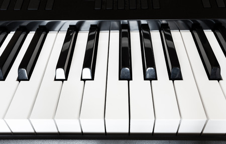 octave: front view of black and white keys of musical digital keyboard close up Stock Photo
