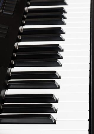 side keys: side view of black and white keys of digital sequencer close up