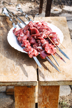 yard stick: raw lamb shish kebabs on skewers in outdoor cafe