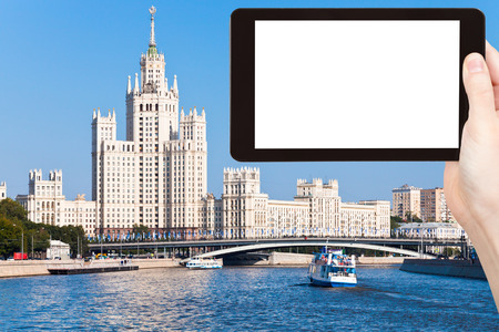 kotelnicheskaya embankment: travel concept - tourist photograph Moscow cityscape with Stalins high-rise building on kotelnicheskaya embankment on tablet pc with cut out screen with blank place for advertising
