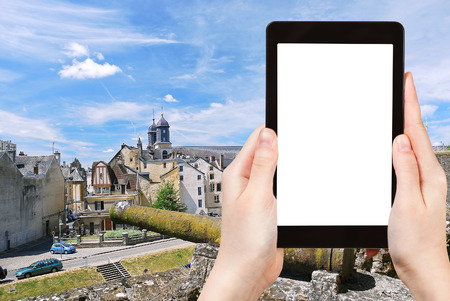 out of town: travel concept - tourist photograph town Sedan from wall, France in summer day on tablet pc with cut out screen with blank place for advertising