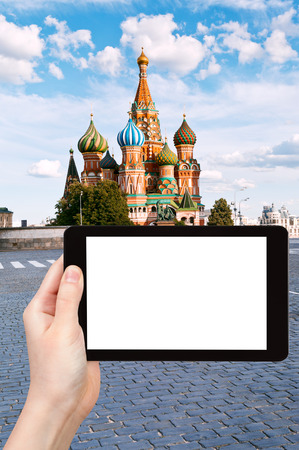 pokrovsky: travel concept - tourist photograph Pokrovsky cathedral on Red square in Moscow, Russia on tablet pc with cut out screen with blank place for advertising  Stock Photo
