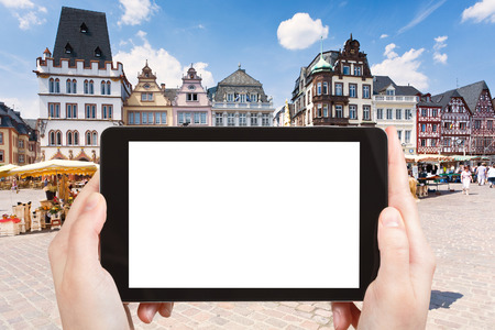hauptmarkt: travel concept - tourist photograph old Market square in Trier, Germany on tablet pc with cut out screen with blank place for advertising