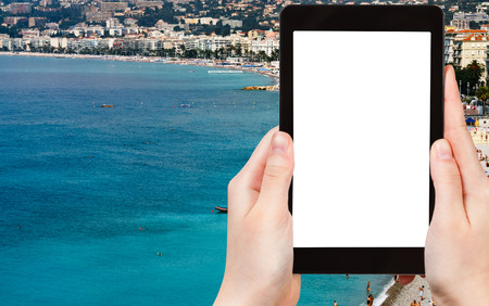 azure coast: travel concept - tourist photograph Azure coast in Nice city, France on tablet pc with cut out screen with blank place for advertising