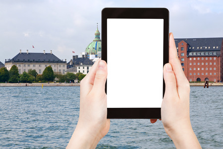 cast in place: travel concept - tourist photograph waterfront, Marble Church and The Royal Cast Collection in Copenhagen, Denmark on tablet pc with cut out screen with blank place for advertising  Stock Photo