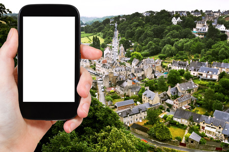 rance: travel concept - tourist photograph above view of town Dinan and river Rance, France on smartphone with cut out screen with blank place for advertising  Stock Photo