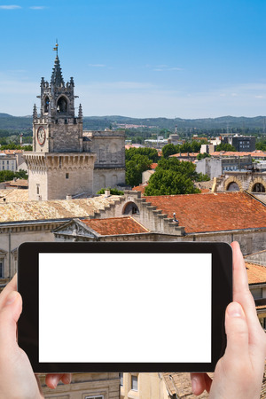 out of town: travel concept - tourist photograph medieval town Avignon, France on tablet pc with cut out screen with blank place for advertising  Stock Photo