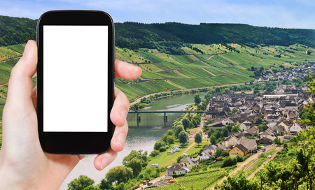 mosel: travel concept - tourist photograph Town Zell and Moselle river, Germany in summer day on tablet pc with cut out screen with blank place for advertising  Stock Photo