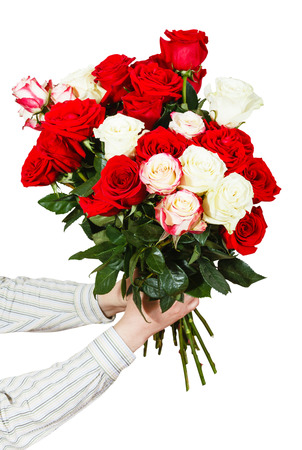 arm bouquet: two hands giving bouquet of many roses isolated on white background