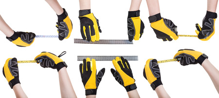mensuration: set of worker hands in safety gloves with measuring tools isolated on white background