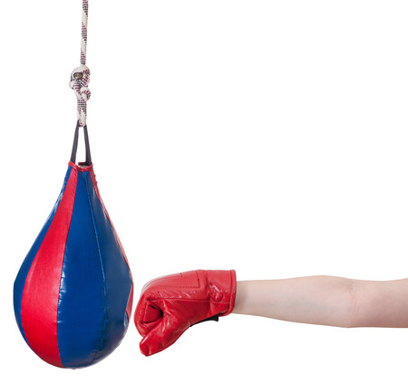 hand gesture - child with boxing glove punches punching bag isolated on white background photo
