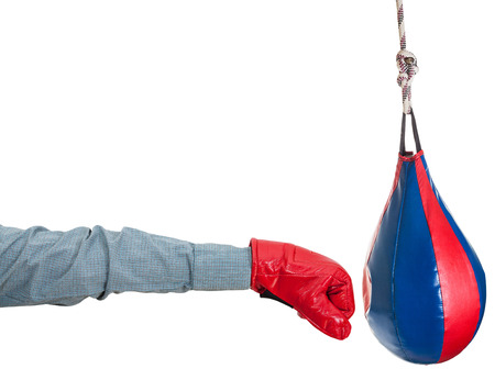 hand gesture - manager with boxing glove punches punching bag isolated on white background photo