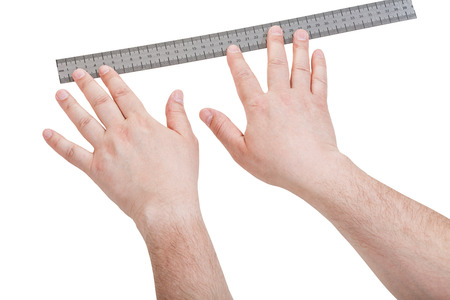 mensuration: male hands with measuring ruler isolated on white background
