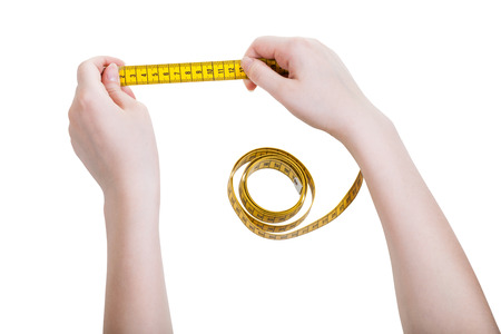 tailor measuring tape: female hands with tailor measuring tape isolated on white background Stock Photo