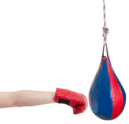 hand gesture - kid with boxing glove punches punching bag isolated on white background photo