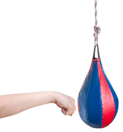 hand gesture - kid punches punching bag isolated on white background photo