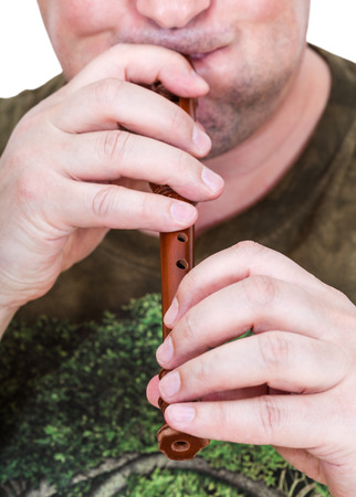 inflated: street musician with inflated cheeks plays flute close up Stock Photo
