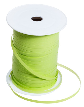 packing tape: white plastic bobbin with green packing tape isolated on white background Stock Photo