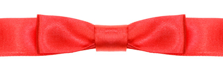 neckband: symmetric red bow knot on wide silk ribbon isolated on white background