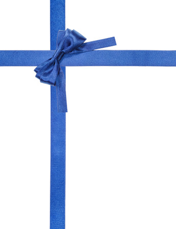 turned: turned blue satin bow in upper right corner and two intersecting ribbons isolated on vertical white background Stock Photo