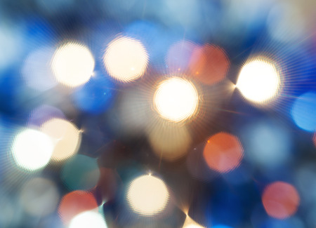 agleam: abstract blurred background - blue shimmering Christmas lights from diffise filter of electric garlands on Xmas tree Stock Photo