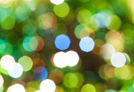 agleam: abstract blurred background - green shimmering Christmas lights of electric garlands on Xmas tree Stock Photo