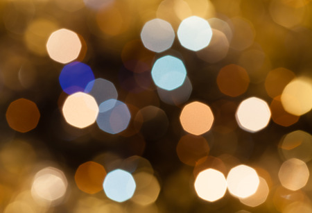 agleam: abstract blurred background - brown and pink shimmering Christmas lights of electric garlands on Xmas tree Stock Photo