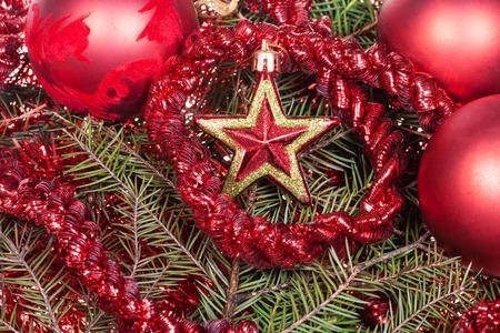 star of life: Christmas still life - red star, Christmas balls, tinsel on Xmas tree background