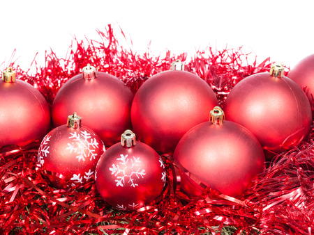 many christmas baubles: many red Christmas baubles and tinsel isolated on white background