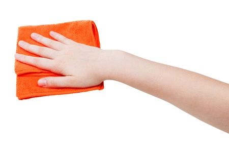 wiping: hand with orange wiping rag isolated on white background Stock Photo