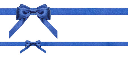 two blue satin bows and two horizontal ribbons isolated on horizontal white background