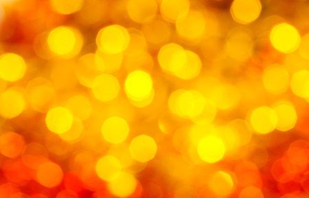agleam: abstract blurred background - yellow and red shimmering Xmas lights of garlands on Christmas tree Stock Photo