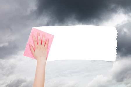 deletes: weather concept - hand deletes gray clouds from sky by pink rag from image and white empty copy space are appearing Stock Photo