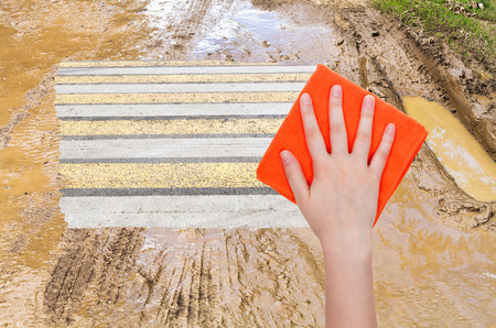 deletes: weather concept - hand deletes mug on country road by orange cloth from image and urban road is appearing