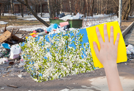 deletes: ecology concept - hand deletes urban trash by yellow cloth from image and spring cherry white blossoms are appearing