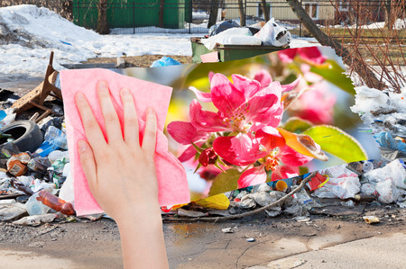 deletes: ecology concept - hand deletes urban dumpsters by pink cloth from image and spring pink blossoms are appearing