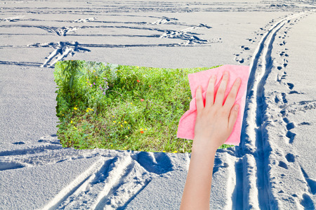 deletes: season concept - hand deletes snow fileld with ski tracks by pink cloth from image and green meadow is appearing