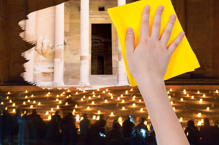 deletes: travel concept - hand deletes night view of Petra by yellow rag from image and day view of ancient town Petra is appearing Stock Photo