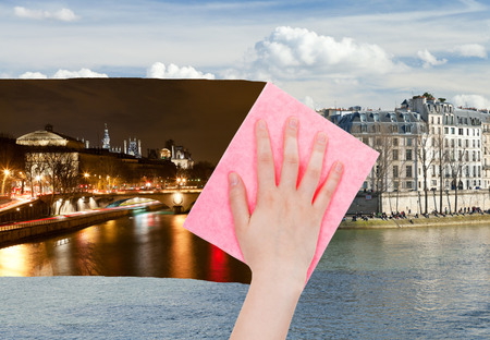 deletes: travel concept - hand deletes night view of Paris by pink cloth from image and day cityscape is appearing Stock Photo