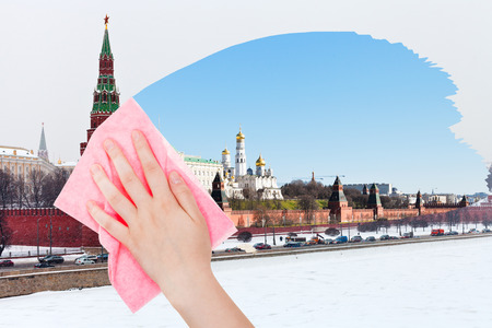 deletes: travel concept - hand deletes winter view of Moscow by pink cloth from image and summer cityscape is appearing Stock Photo