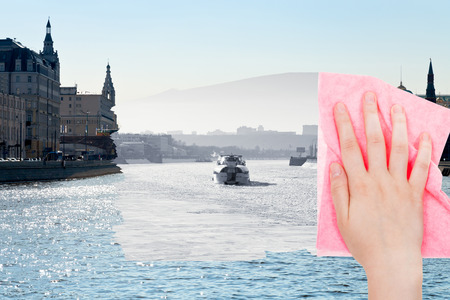 deletes: travel concept - hand deletes winter view of Moscow River by pink cloth from image and summer cityscape is appearing Stock Photo