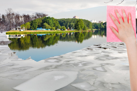 deletes: season concept - hand deletes ice floe in winter river by pink cloth from image and summer river is appearing