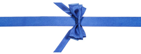 vertically: real blue satin bow with vertically cut ends on narrow ribbon isolated on white background