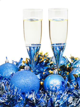 silver flute: two glasses of champagne at blue Christmas balls and tinsel isolated on white background Stock Photo