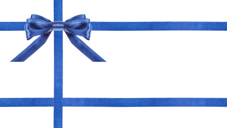 cross ties: one blue satin bow in upper left corner and three intersecting ribbons isolated on horizontal white background Stock Photo