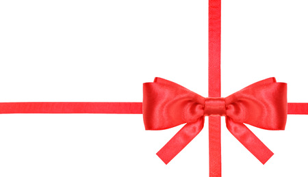 banding: one red satin bow lower right corner and two intersecting ribbons isolated on horizontal white background