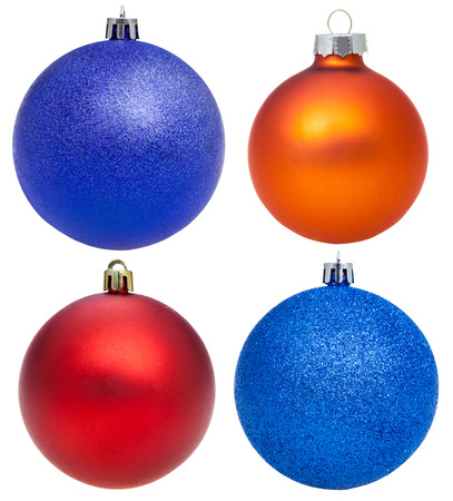 xmas background: christmas decorations - four glass xmas balls isolated on white background