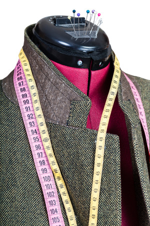 tweed: tailoring of man tweed jacket on mannequin isolated on white background