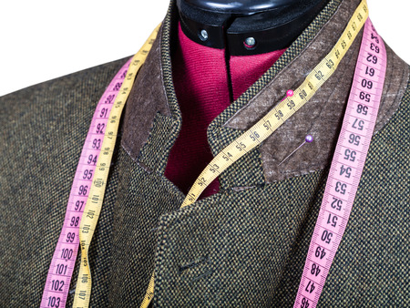 tweed: tailoring of collar for tweed jacket on mannequin isolated on white background Stock Photo
