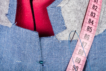 tailoring: tailoring of collar for silk jacket on mannequin close up Stock Photo